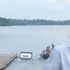 CAUGHT ON CAMERA: Brand New Truck Rolls Into Lake During Live TV Report In Illinois