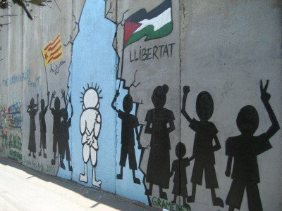 A graffiti of Naji al-Ali's Handala on the West Bank separation wall