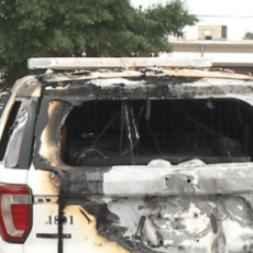 Leftist Journalist, BLM Activists Charged in Firebombing of Arkansas Cop Cars