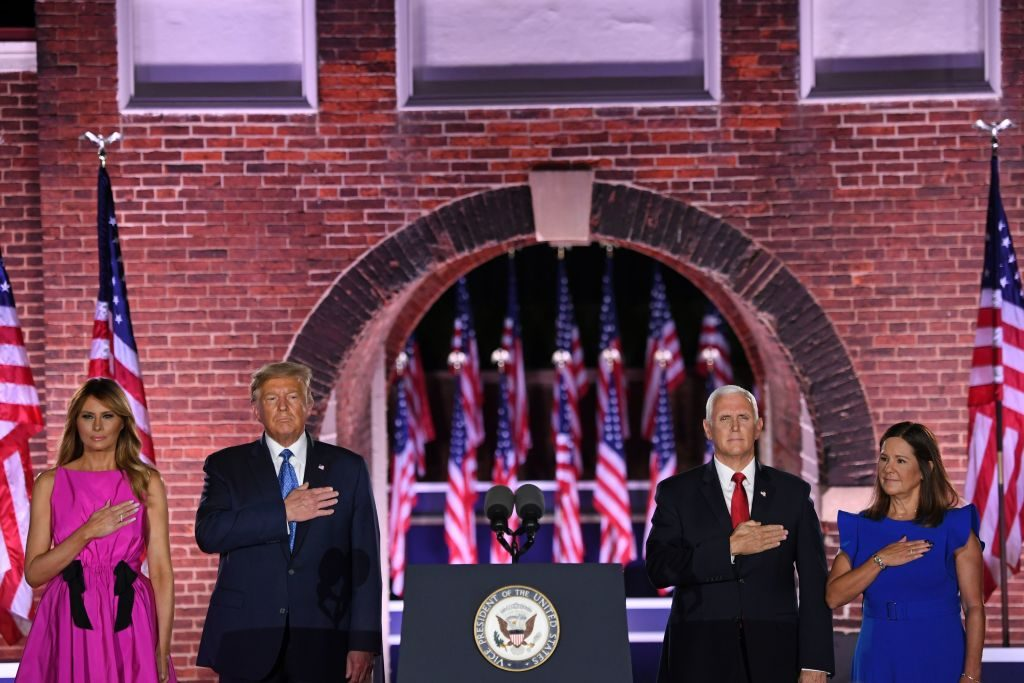 """(From L) US First Lady Melania Trump, US President Donald Trump, US Vice President Mike Pence and Second Lady Karen Pence listen to the US National Anthem, """"the Star-Spangled Banner"""", during the third night of the Republican National Convention at Fort McHenry National Monument in Baltimore, Maryland, August 26, 2020. (Photo by SAUL LOEB / AFP) (Photo by SAUL LOEB/AFP via Getty Images)"""