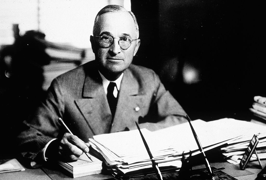 "UNDATED FILE PHOTO: (FOR EDITORIAL USE ONLY) Harry S. Truman (1884-1972), the 33rd president of the United States, works at his desk in 1945. A newly discovered diary written by Truman was put on display at the National Archives July 10, 2003 in Washington, DC. Diary entries include controversial passages where Truman calls Jews ""selfish,"" and the White House a ""great white jail."" The diary also reveals that Truman had asked Eisenhower to run as a Democrat with himself as his running mate. (Photo by Getty Images)"