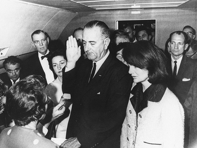 Flanked by Jackie Kennedy (R) and his wife Lady Bird Johnson (2ndL), U.S Vice President Lyndon Johnson (C) is administred the oath of office by Federal Judge Sarah Hughes (L) as he assumed the presidency of the U.S., 22 November 1963, following the assassination of President John F. Kennedy in Dallas (Photo by - / JFK Presidential Library / AFP) (Photo credit should read -/AFP via Getty Images)