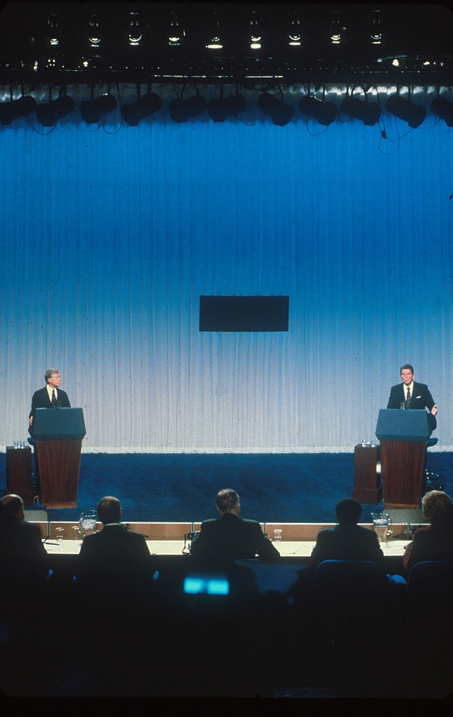 020817 11: Jimmy Carter and Ronald Reagan debate each other from separate podiums October 31, 1980 prior to the 1980 presidential election. (Photo by Liaison)