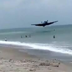 SEE IT: World War II-era plane makes emergency landing in surf off of Florida beach!