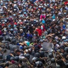 WATCH: Guatemalan Security Forces Push Migrant Caravan Back