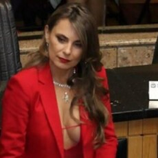 Well Endowed Lawmaker Brings Heat Over 'Outfit Choices'